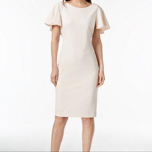 Light pink Calvin Klein cape dress
